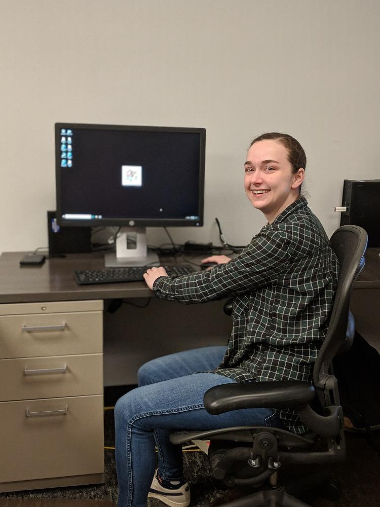 Research Assistant Tara Trentelange tests out the public access computer